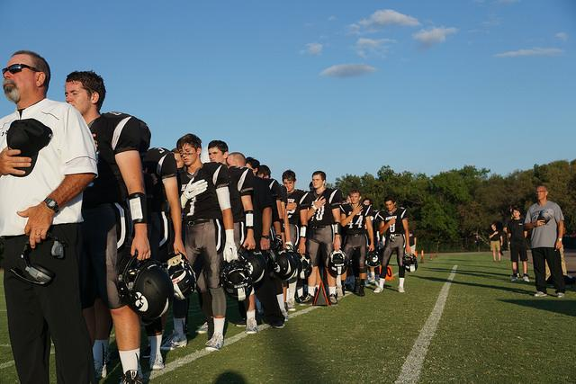 The Hawks take a moment for the national anthem before starting the game. Photo credit CPS Exodus 2015